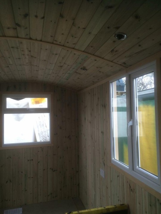 Photo of huts interior side windows on the right.