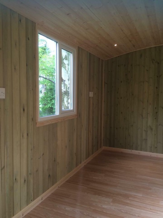 Photo of the wooden interior of a shepherds hut.