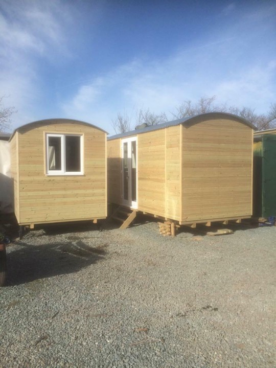 Photo of two shepherds huts ready for delivery.