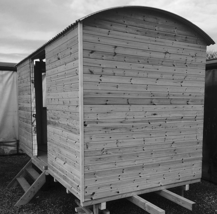 Black and white photo of a Shepherds Hut.